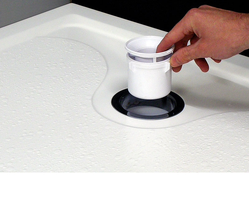 Step in shower tray waste outlet with cleaning cup.