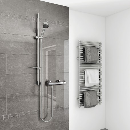 Vettora thermostatic controlled mixer shower shown installed in stunning wetroom